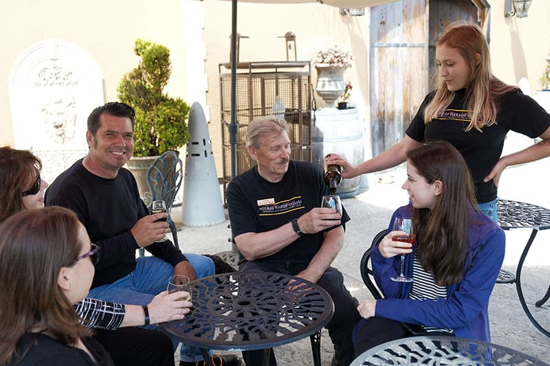 Group enjoying a glass of wine on our outdoor patio